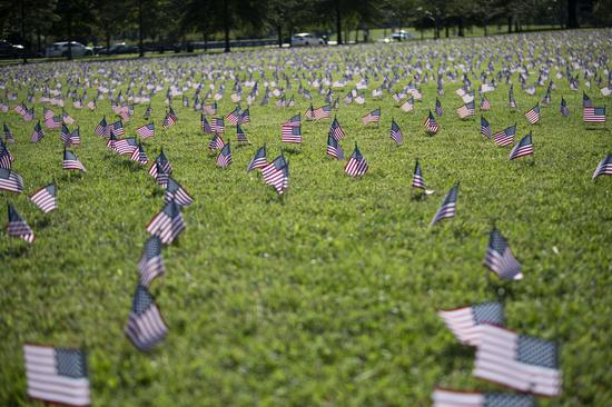 U.S. national flags representing the 200,000 lives lost to COVID-19 in the United States are placed on the National Mall in Washington, D.C., the United States, on Sept. 22, 2020. U.S. COVID-19 deaths surpassed 200,000 on Tuesday, according to the Center for Systems Science and Engineering (CSSE) at Johns Hopkins University. (Xinhua/Liu Jie)
