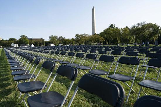 Empty chairs sit on the Ellipse near the White House in Washington, D.C., the United States, on Oct. 4, 2020. Twenty thousand empty chairs were set up near the White House on Sunday to mourn the more than 200,000 lives lost in United States from COVID-19. (Xinhua/Liu Jie)