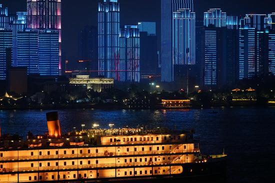 A light show is displayed along the Yangtze River in Wuhan, central China's Hubei Province, Oct. 1, 2020. (Xinhua/Feng Guodong)