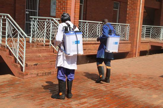 Workers fumigate the campus to combat the spread of COVID-19 at the University of Zimbabwe in Harare, capital of Zimbabwe, Sept. 22, 2020. (Xinhua/Tafara Mugwara)