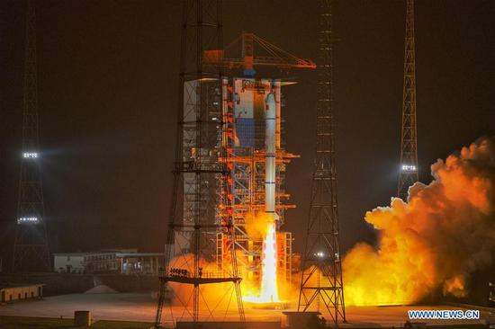 A Long March-2C carrier rocket blasts off from the Xichang Satellite Launch Center in southwest China's Sichuan Province on Oct. 26, 2020. China successfully sent a group of new remote-sensing satellites into orbit from the Xichang Satellite Launch Center in southwest China's Sichuan Province on Monday. Belonging to the Yaogan-30 family, the satellites were launched by a Long March-2C carrier rocket at 11:19 p.m. (Beijing Time). (Photo by Guo Wenbin/Xinhua)
