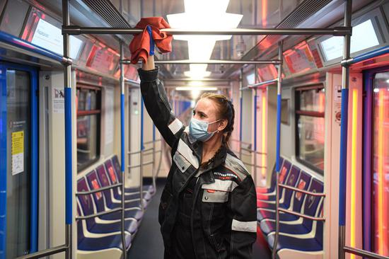 A subway worker cleans the train during the disinfection procedure at the depot Sviblovo in Moscow, Russia, on Oct. 22, 2020. (Xinhua/Evgeny Sinitsyn)