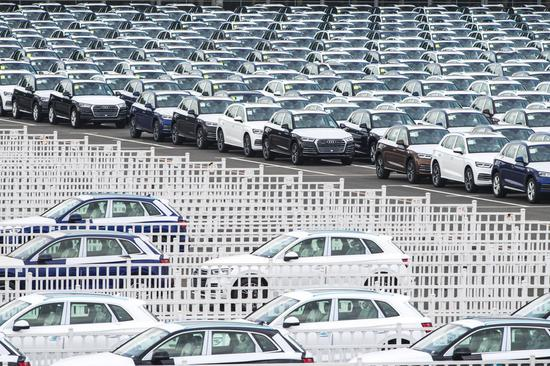 Photo taken on July 9, 2019 shows Audi vehicles awaiting transfer at the parking lot of FAW-Volkswagen in Changchun, northeast China's Jilin Province. (Xinhua/Xu Chang)