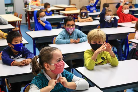 Students attend a class wearing face masks after Halloween break in Antibes, southern France, Nov. 2, 2020. (Photo by Serge Haouzi/Xinhua)