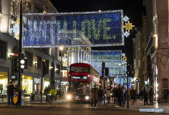Christmas lights illuminate main shopping Oxford Street in London