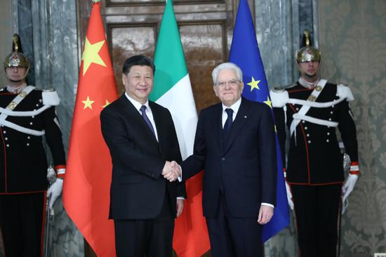 President Xi Jinping shakes hands with his Italian counterpart Sergio Mattarella in Rome, Italy, March 22, 2019. (Photo/Xinhua)