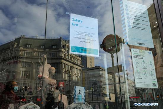A notice of closure is seen on the window of a shop in London, Britain, on Nov. 5, 2020. British Prime Minister Boris Johnson on Thursday said that the month-long lockdown in England, which came into force earlier in the day, is enough to