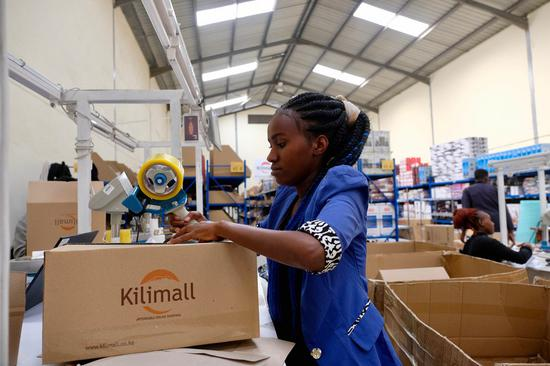An employee packages goods at a warehouse of e-commerce platform Kilimall in Nairobi, capital of Kenya, Nov. 1, 2019. (Xinhua/Yang Zhen)