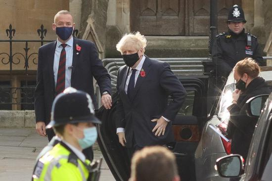 British Prime Minister Boris Johnson arrives at Westminster Abbey to attend a service to mark Armistice Day in London, Britain, Nov. 11, 2020. (Photo by Tim Ireland/Xinhua)
