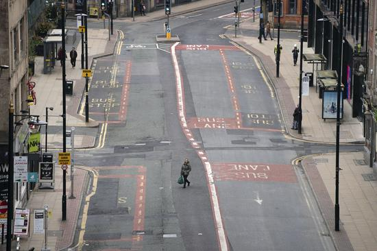 Photo taken on Nov. 5, 2020 shows empty streets in Manchester, Britain. (Photo by Jon Super/Xinhua)