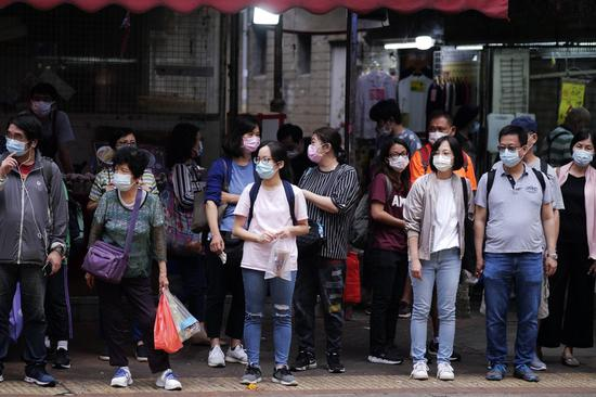 HKSAR officials call for vigilance as fresh COVID-19 infections hit new high