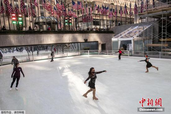 The rink at rockefeller center opens for ice skating season in a limited way