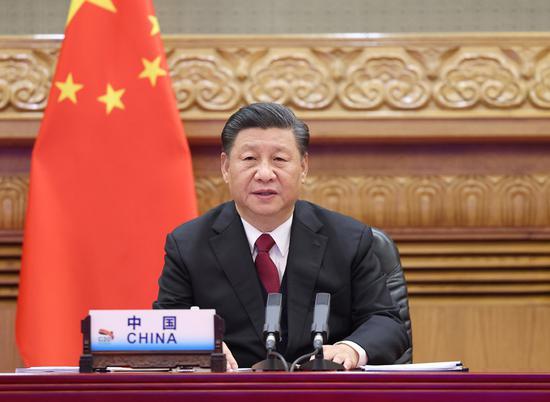 2020年11月22日,中国国家主席习近平通过视频链接出席在中国首都北京举行的第15届G20领导人峰会第二部分。(新华社/王烨)