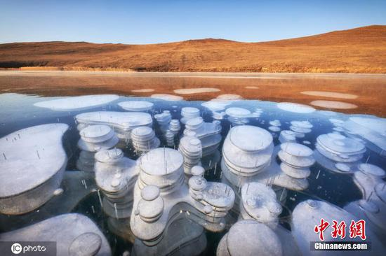 Beauty of frozen methane bubbles on the world's deepest lake