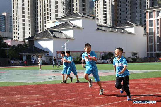 upils run on the playground at a primary school in Longnan city, Northwest China's Gansu province, on Aug 31, 2020. (Photo/Xinhua)