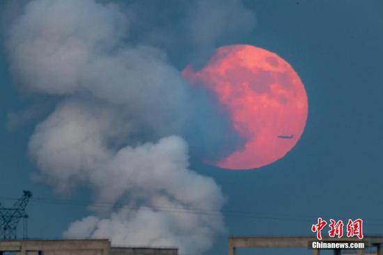 Penumbral eclipse appears in sky over North China