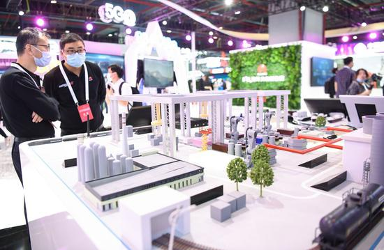 Photo taken on Nov. 26, 2020 shows a model of a 5G-supported smart factory at a 5G-themed exhibition held during the World 5G Convention in Guangzhou, south China's Guangdong Province. (Xinhua/Deng Hua)