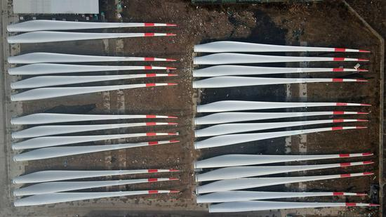 Aerial photo taken on Dec. 8, 2020 shows giant blades for wind power generators manufactured by a company in Weixian County of north China's Hebei Province. (Xinhua/Mu Yu)