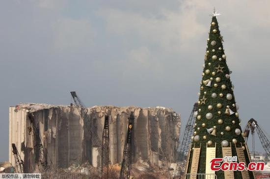Christmas tree with names of those who died during Beirut port seen near damaged grain silo