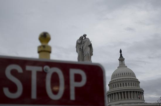 The Capitol and a stop sign are seen in Washington D.C., the United States, on Feb. 13, 2020. (Xinhua/Liu Jie)