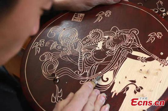 Dunhuang culture carved on wooden boards