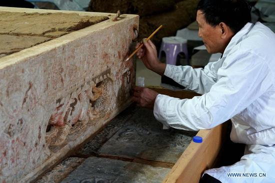 1,400-yr-old tomb with white marble bed reveals religious exchanges on Silk Road