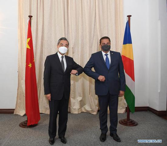 Chinese State Councilor and Foreign Minister Wang Yi (L) holds talks with his Seychelles counterpart Sylvestre Radegonde in Victoria, Seychelles, Jan. 9, 2021. (Xinhua/Li Yan)