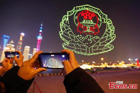 Drones light up sky over Bund celebrating Police Festival