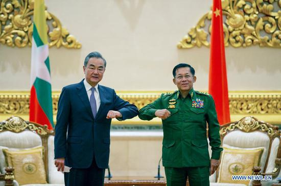 Chinese State Councilor and Foreign Minister Wang Yi (L) meets with Myanmar's Commander-in-Chief of Defense Services Min Aung Hlaing in Nay Pyi Taw, Myanmar, Jan. 12, 2021. (Xinhua/Zhang Dongqiang)