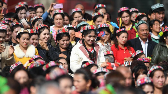 People attend a culture and tourism festival themed on Dolan and Qiuci culture in Awat County of Aksu Prefecture, northwest China's Xinjiang Uygur Autonomous Region, October 25, 2019. (Photo /Xinhua)