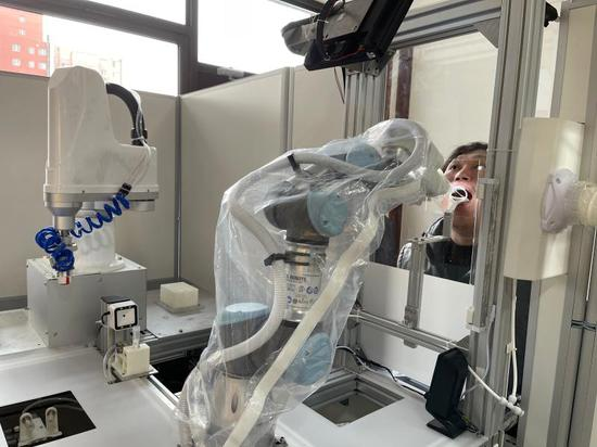Chinese city uses robots to collect throat swab samples for COVID-19 testing