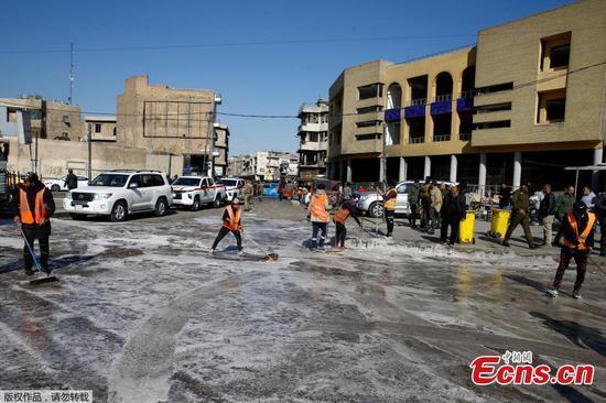 在巴格达的一个中央市场发生的罕见的双生子自杀炸弹袭击