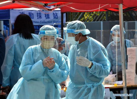Hong Kong imposes first COVID-19 lockdown on virus-hit district