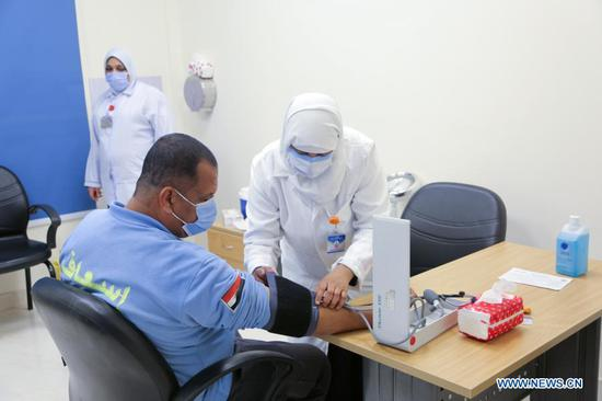 Egypt starts vaccinating medics with Sinopharm COVID-19 vaccine