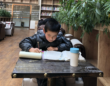 For holiday in Tibet, some go to the library