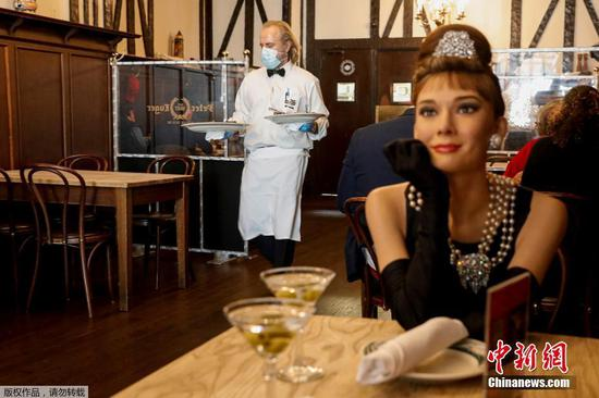 Wax stars join diners at NYC restaurant for COVID-19 safe experience