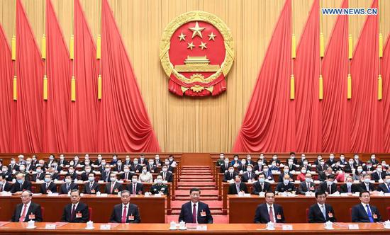 The closing meeting of the fourth session of the 13th National People's Congress (NPC) is held at the Great Hall of the People in Beijing, capital of China, March 11, 2021. Leaders of the Communist Party of China and the state Xi Jinping, Li Keqiang, Wang Yang, Wang Huning, Zhao Leji, Han Zheng and Wang Qishan attended the meeting, and Li Zhanshu presided over the closing meeting and delivered a speech. (Xinhua/Xie Huanchi)