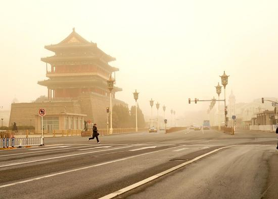 The Zhengyang Gate is seen shrouded in dust in Beijing, capital of China, March 15, 2021. Beijing was enveloped in yellow dust on Monday morning with visibility at less than 1 km, as the city's meteorological department issued a yellow warning for sandstorms, the third-most hazardous level. (Xinhua/Zhang Chenlin)