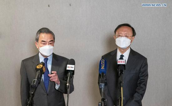 Yang Jiechi, a member of the Political Bureau of the Communist Party of China (CPC) Central Committee and director of the Office of the Foreign Affairs Commission of the CPC Central Committee, and Chinese State Councilor and Foreign Minister Wang Yi receive an interview with media following the end of the high-level strategic dialogue with the United States in the Alaskan city of Anchorage on March 19, 2021. (Xinhua/Liu Jie)