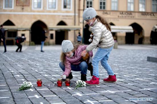 Old Town Square painted with white crosses in memory of victims of COVID-19 pandemic in Prague