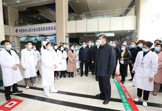 President Xi Jinping, also general secretary of the Communist Party of China Central Committee and chairman of the Central Military Commission, learns about the reform of local medical and healthcare system at Shaxian General Hospital in Shaxian District of Sanming City, east China's Fujian Province, on March 23, 2021. (Xinhua/Wang Ye)
