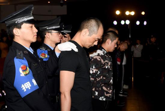 A court in Xi'an, Shaanxi province, sentences eight people for gang-related loan-sharking in March, 2019. (LIU XIAO/XINHUA)