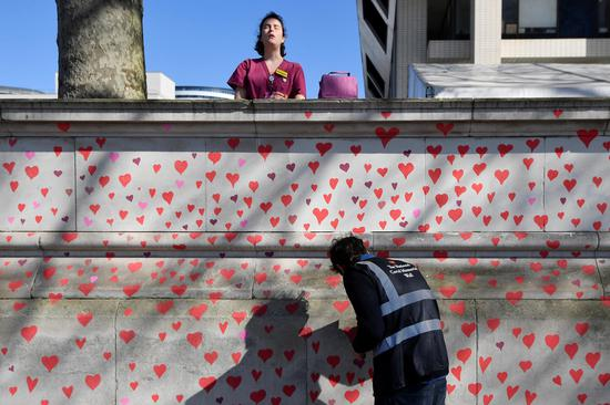 Wall of hearts painted as a memorial to COVID-19 deaths
