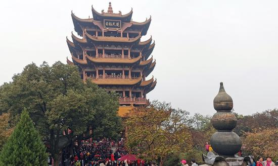 Tourists visit the Huanghe Lou (Yellow Crane Tower) in Wuhan. (Photo: VCG)