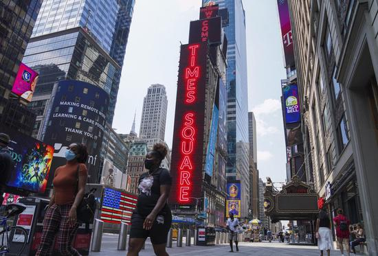 People walk in Times Square in New York, the United States, on Aug. 9, 2020. (Xinhua/Wang Ying)