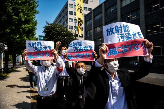 People protest against the discharge of wastewater into the sea in Tokyo