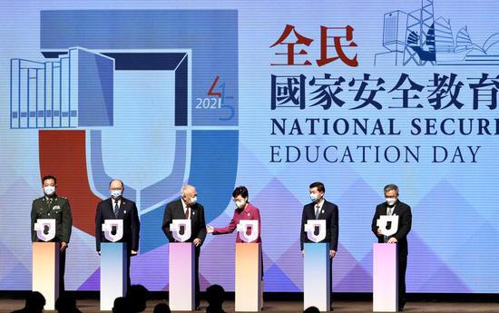 Chief Executive Carrie Lam Cheng Yuet-ngor (fourth left) leads in officiating in the opening ceremony of the