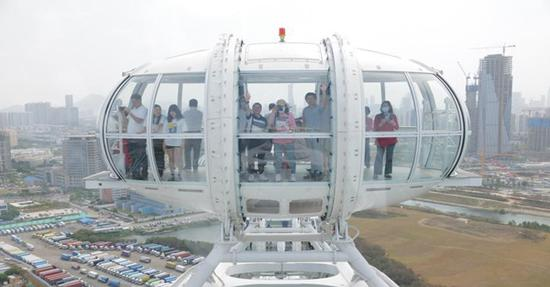 Ferris wheel 'Light of the Bay Area' opens to public in Shenzhen