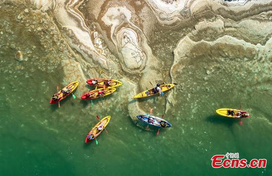 Kayaking on the crystal Dead Sea creates 'illusion'