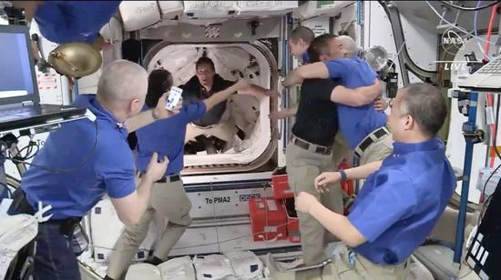 Astronauts aboard SpaceX Crew Dragon arrive at space station